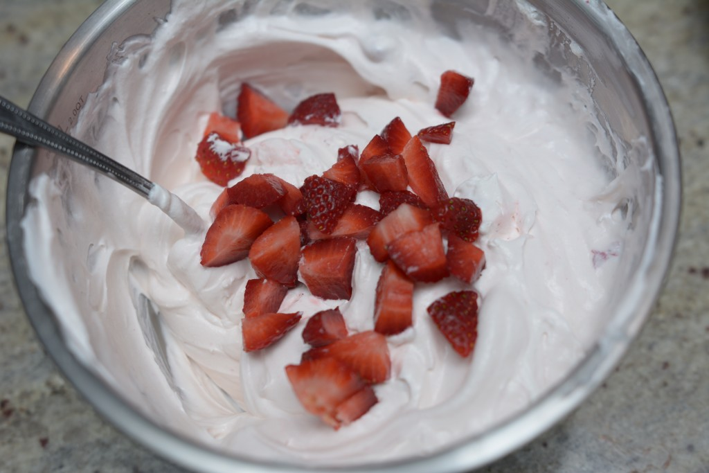Mix yogurt, Cool Whip and strawberries together in a bowl.